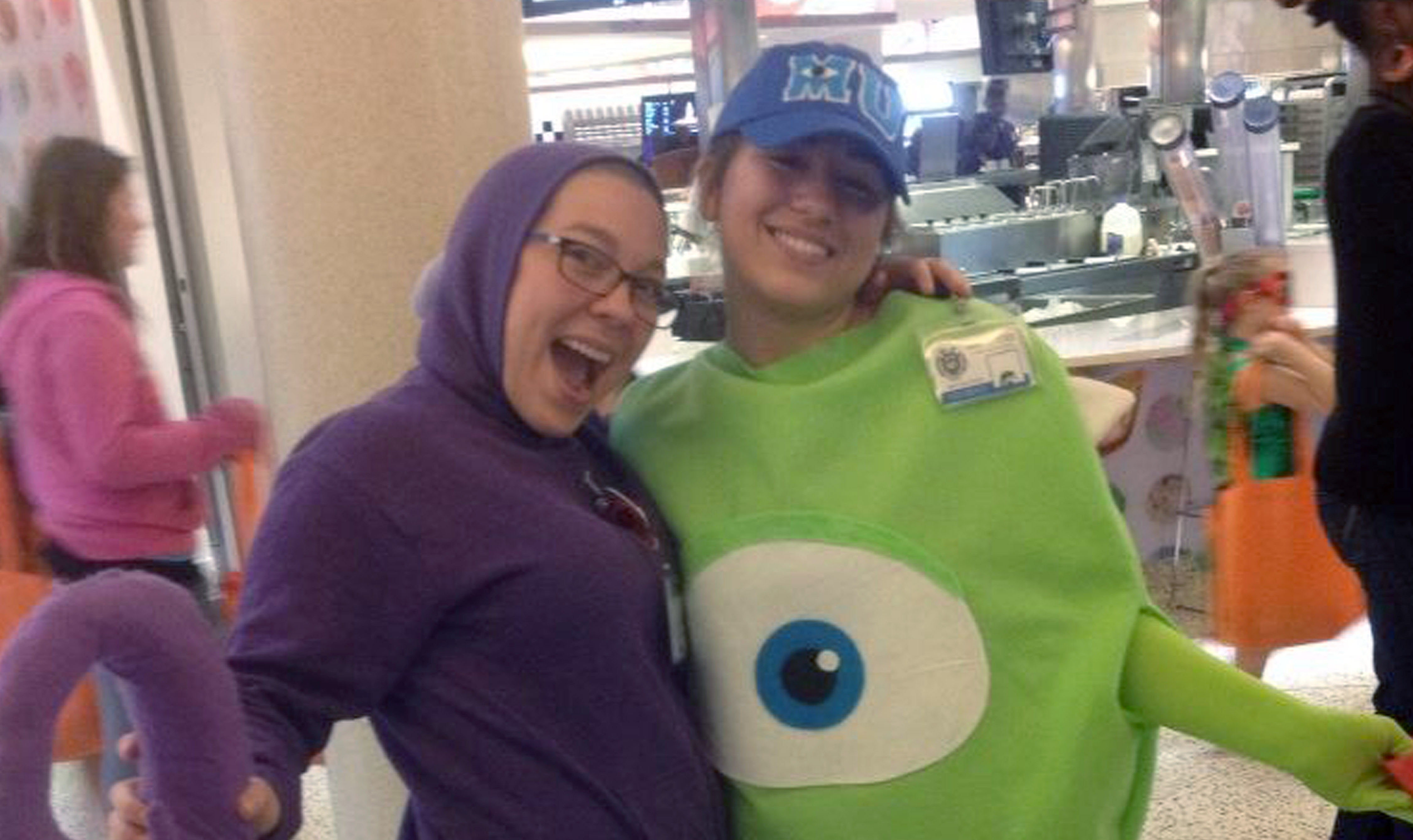 Lidija and coworker dressed as monsters for a Halloween party
