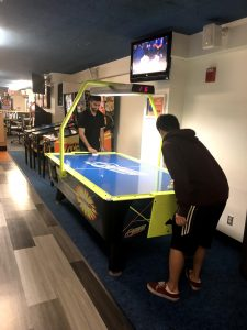 Two Carle Illinois students playing air hockey, Carle Illinois College of Medicine, University of Illinois at Urbana-Champaign