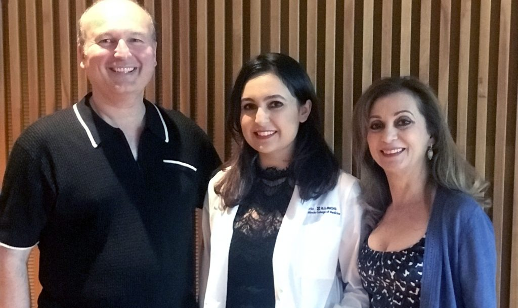 Roxy with her parents at her Carle Illinois white coat ceremony.