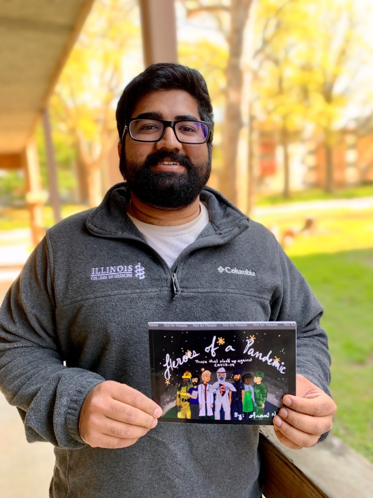 Anant Naik with his children's book, Heroes of a Pandemic