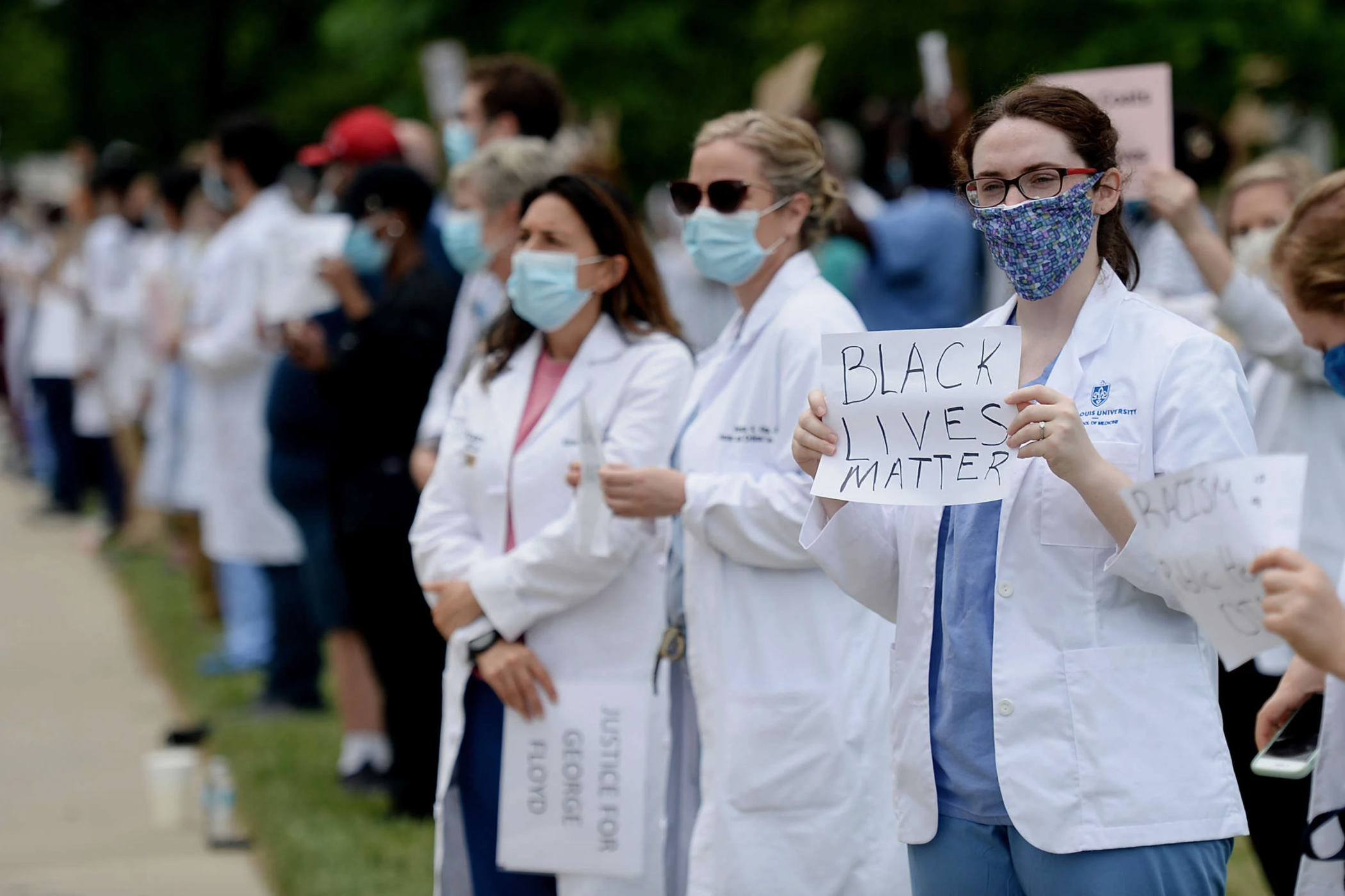 Several hundred doctors, nurses and medical professionals come together to protest against police brutality and the death of George Floyd at Barnes-Jewish Hospital on June 5, 2020, in St. Louis, Missouri.